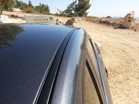 בייקמוביל מאזדה 3 החדשה. מסילות גג להתקנת גגון קבוע - תיתכן השפעה דרמטית על צריכת הדלק - גם ללא אופניים. צילום: רוני נאק