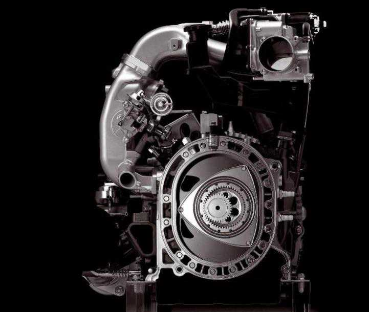 """מנוע וונקל. רוטור אקצנטרי בתא בעירה אובאלי. מעט חלקים נעים, לא צריך להפוך תנועה קווית לסיבובית אבל שחיקה גבוהה של """"פינות"""" הרוטור. צילום: מאזדה"""