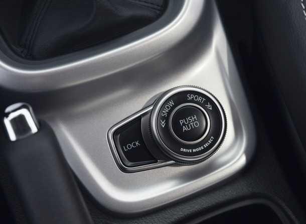 מבחן רכב סוזוקי ויטארה AllGrip. המתג הזה משפיע על הפרמטרים של כמה מערכות ברכב כדי להיבא אותך לצד השני של השביל. צילום: סוזוקי